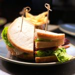 The Falcon Club sandwich, served with skinny fries
