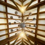 The chandelier and wooden beams from below