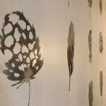 Deatil shot of feather wall paper that features in the restaurant area