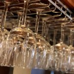 Detail shot of wine glasses hanging in the bar