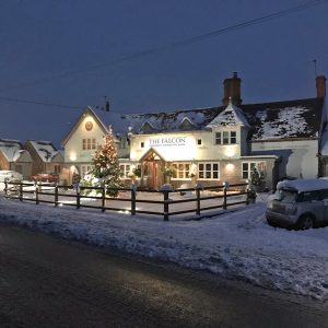 The Falcon at Hatton in winter, covered in snow and lit by lights