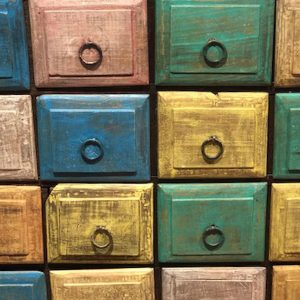 Close up of colourful square, rustic drawers