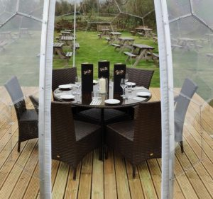 A private dining dome set up for six guests